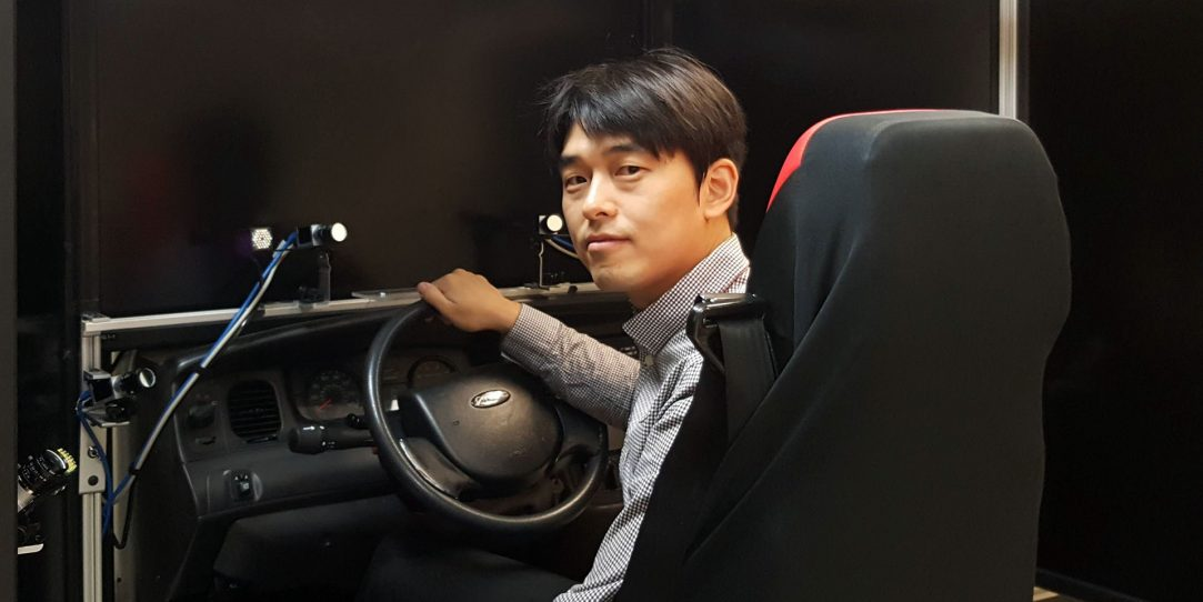 man shown testing assistive technology automotive controls in a lab